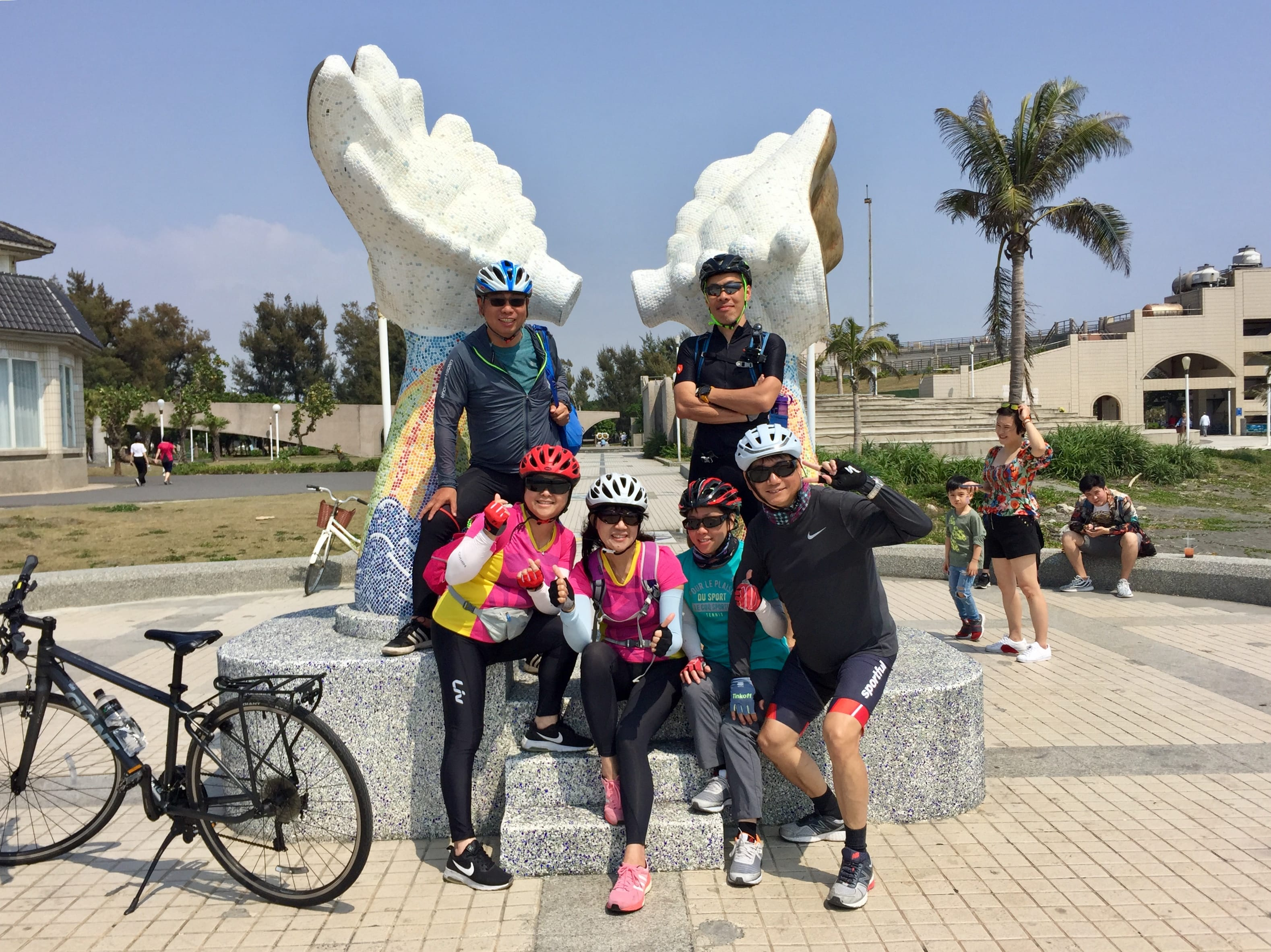 Buddies posed at the Double Whelk Statue