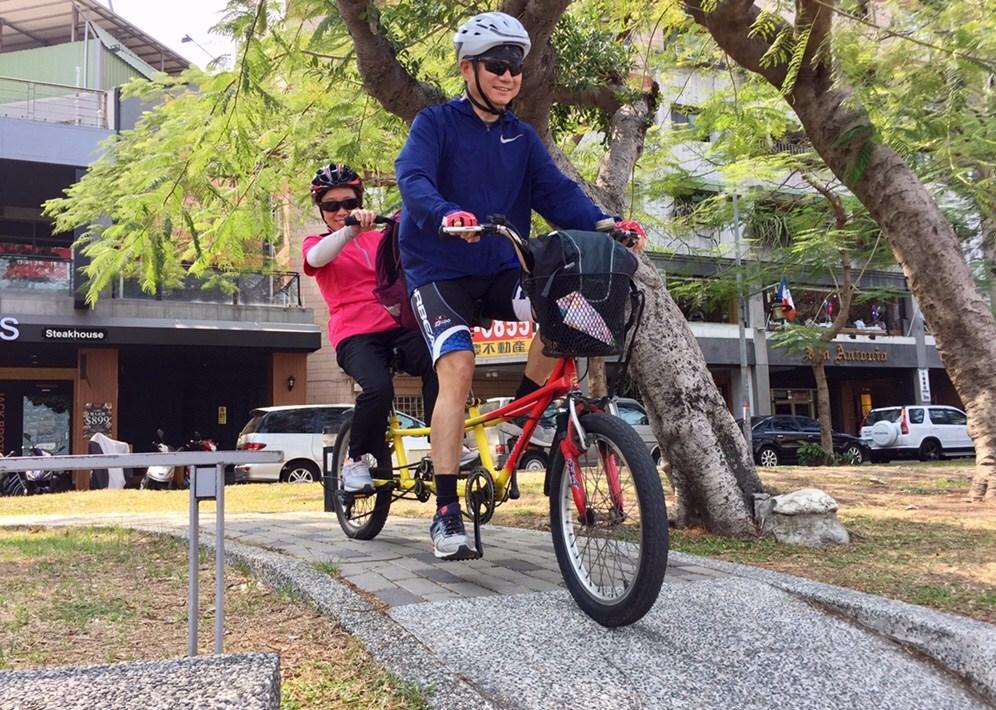 Couple riding on a Tandam Bike