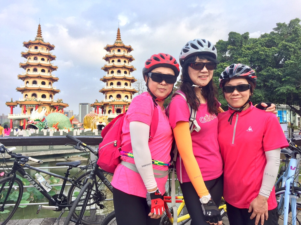 Our sweet pink ladies in front of the Dragon and Tiger Pagodas at the Lotus Pond