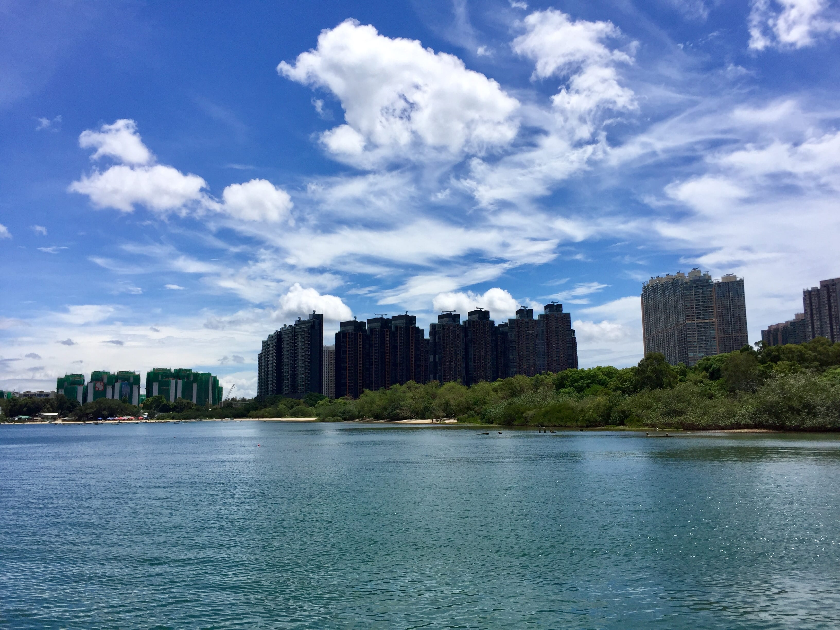 Wu Kai Sha Beach with high rise luxury apartments in the background