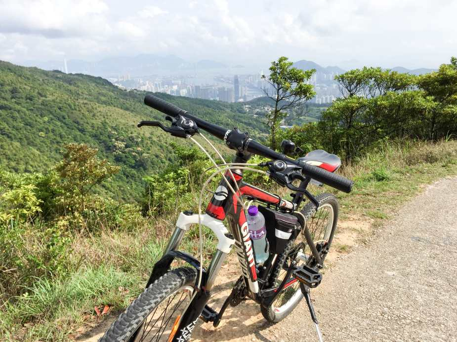 Climbing along Tai Mo Shan Road with Tusen Wan in the background