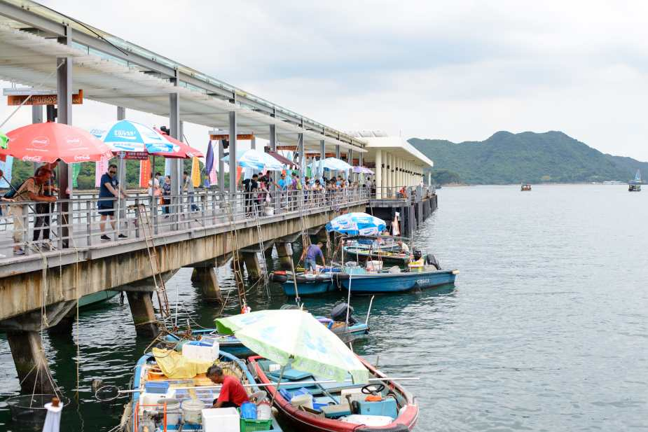 Small boats selling fresh seafoods along the public ferry pier