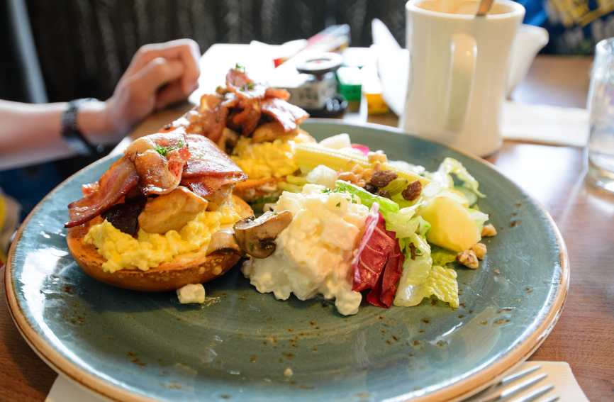 Scrambled Eggs with Bagel, Bacon, Mushroom, Potato and Salad