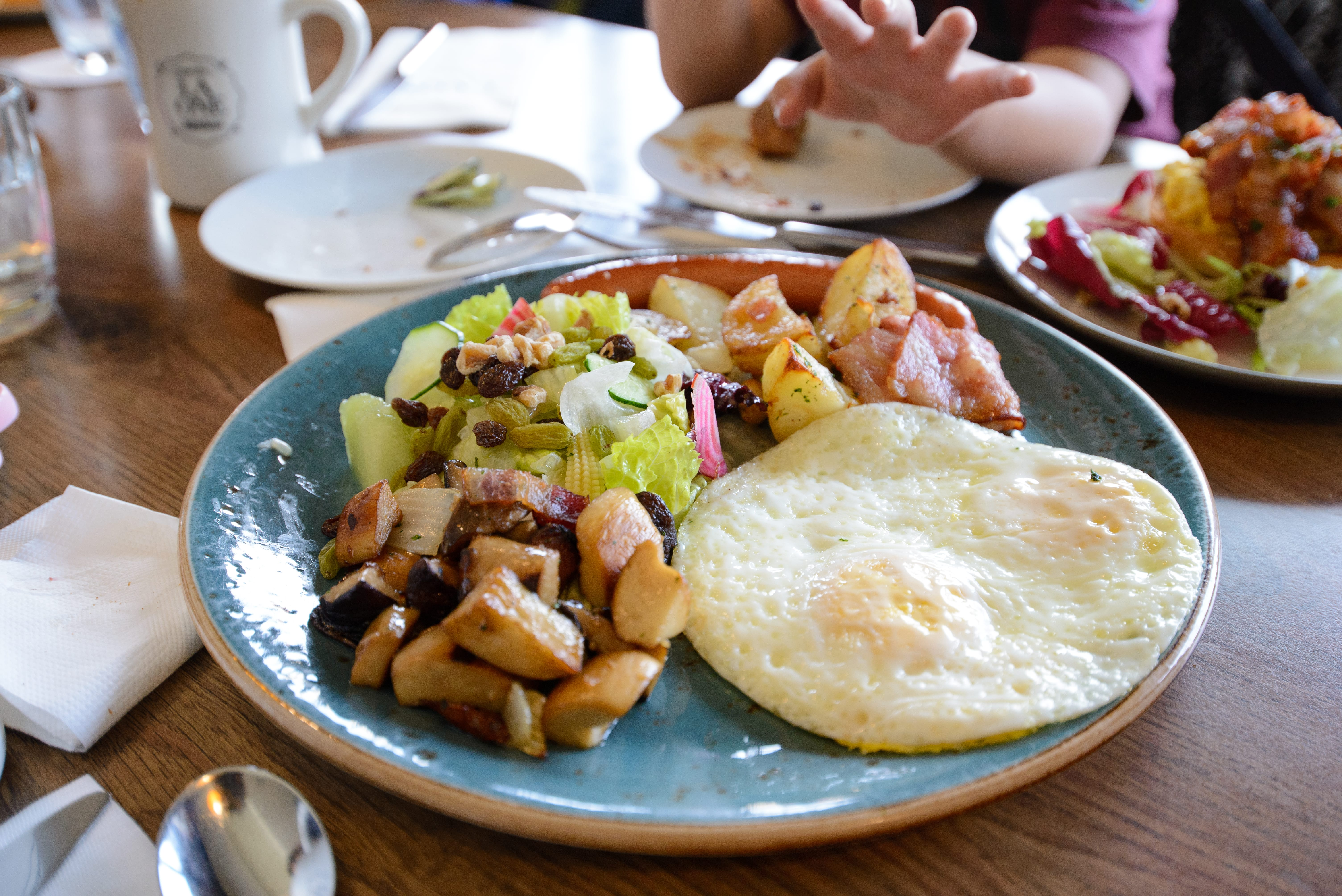 Sunny Eggs with Potato, Mushroom, Bacon, Sausage, Salad and Bread