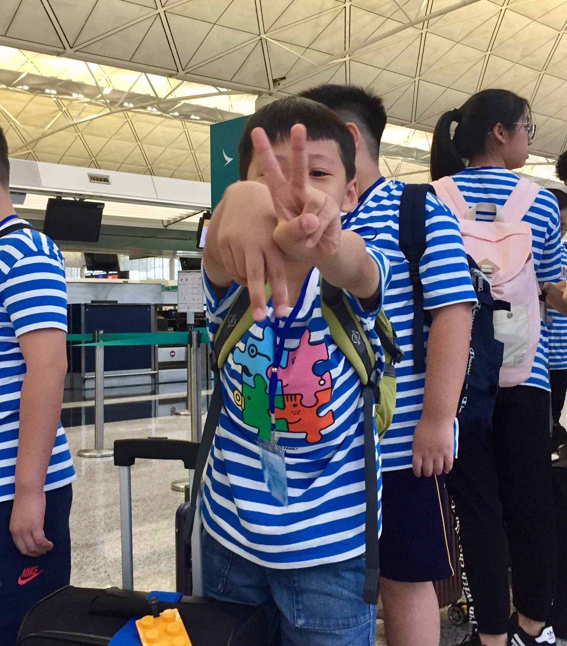 Little boy ready for check-in and baggage drop-off