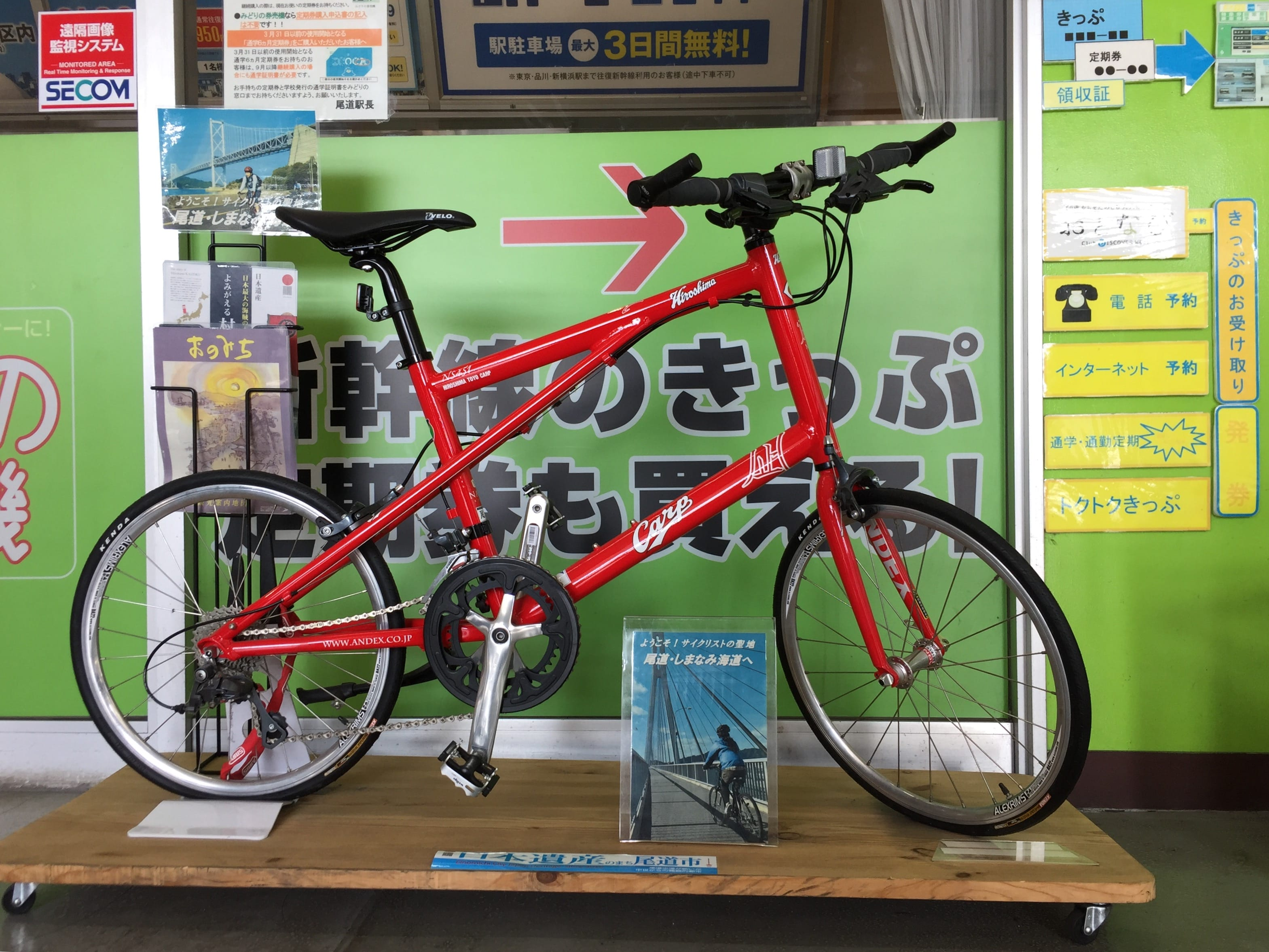 Small wheel road bike shown in a demonstration booth at Onomichi Station
