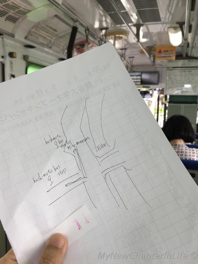 Hand drawn instruction for changing bus to Miho Museum