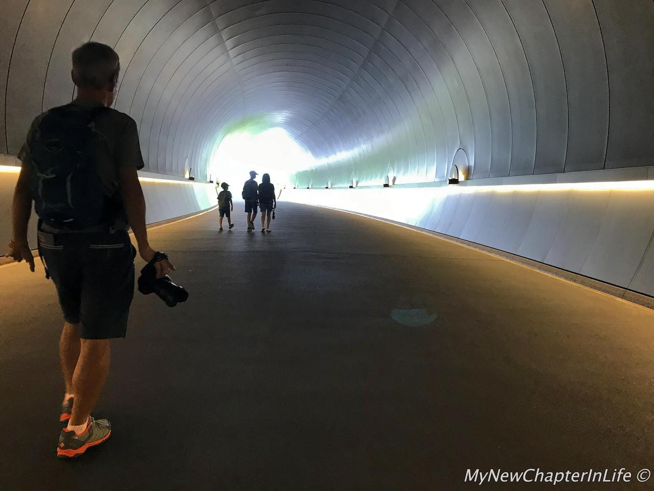 Strolling along the metallic tunnel and prepare for the scenery ahead